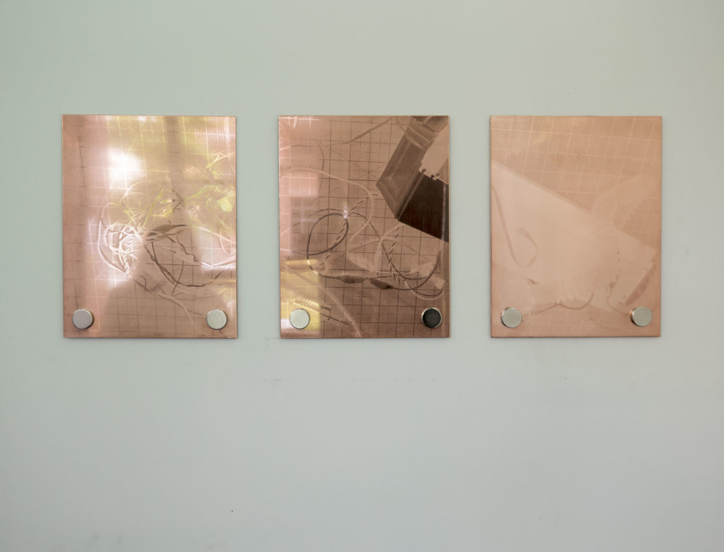 If you touch me, you'll understand what happiness is - triptych of copper printmaking plates depicting the final assembly of the cooling chamber